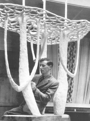 Image of Bernard Reynolds with the sculpture 'Triple Mycomorph' 1950