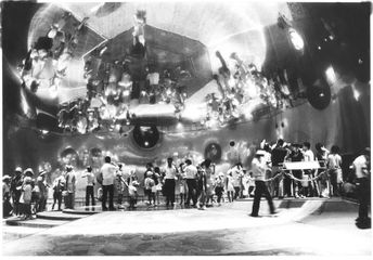 Mirror Dome Room at the Pepsi Pavilion, at Expo '70, Osaka Japan, Photo Shunk-Kender   The 90 ft. 210 degree spherical mirror produced a real image of the floor and the people on it, hanging upside down above their heads. The mirror grew out of Robert Whitman's involvement in optics.