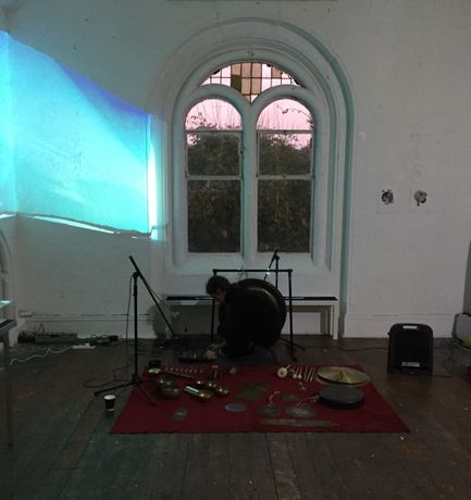 Kosmo Love setting up for A Concert of Improvised Sound at Umbra Sumus