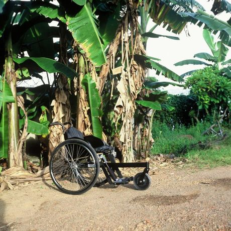 Motivation Rough Terrain Wheelchair, 2005. This wheelchair navigates rough, unpaved, and uneven terrain, specifically in the developing world where the ground may be mud or sand. The three rather than four wheels provide extra Access+Ability stability when pushing, propelling, and even tipping around obstacles.
