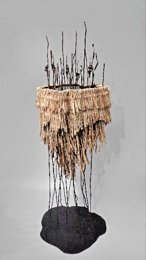 Hale Tenger History of Time 1990 Iron, wicker, bronze, sump oil 50 x 45 x 170 cm.