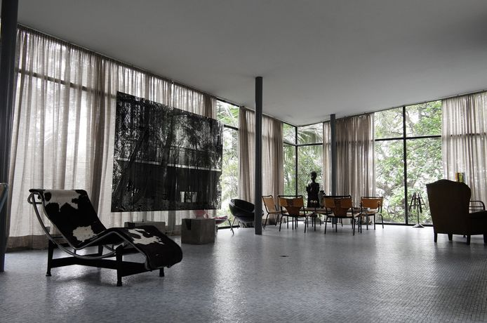 Interior of Glass House (Casa de Vidro) by Lina Bo Bardi, with Veronika Kellndorfer, transparent silkscreen print on glass, installation view, 2014. Courtesy of Christopher Grimes Gallery.