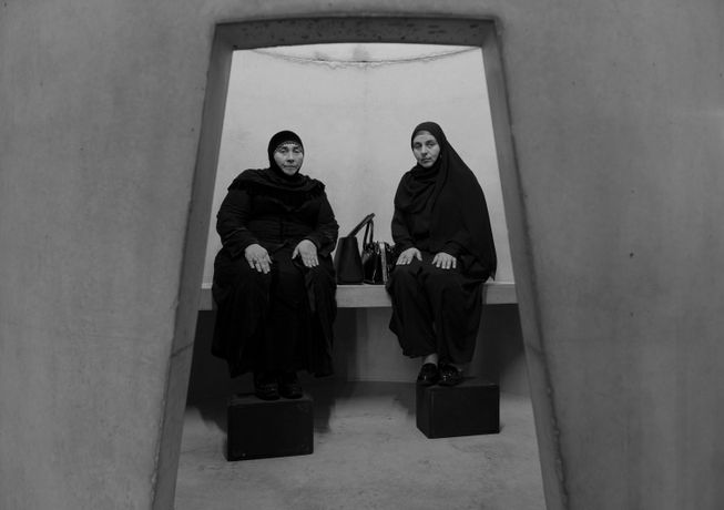 Two Azerbaijani mourners in the concrete structures erected as part of Taryn Simon's An Occupation of Loss performed at the Park Avenue Armory in New York in 2016.