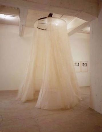 """(filament · I)"", 1996  organza fabric, steel mount with electronic controller  curtain height 365cm, overall installation height variable curtain diameter when spinning, ca. 304.8cm, steel diameter 156cm  First of three versions"