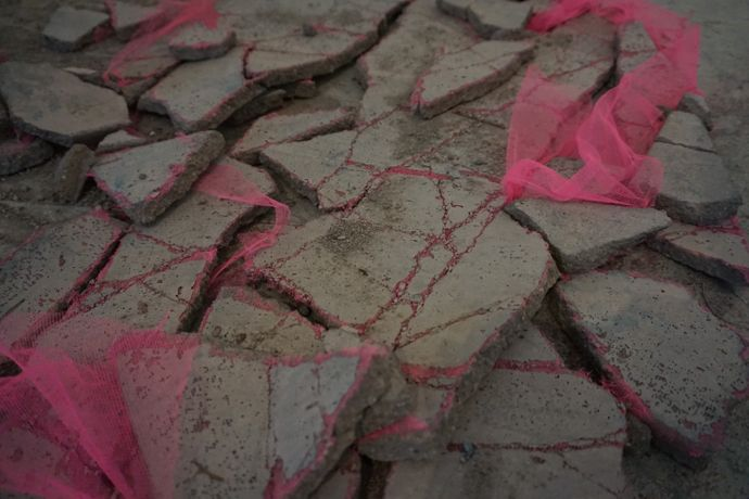 Owen Armour, Untitled (Hard stone hot pink), concrete, fishnet, 140 x 80 x 2 cm, Denmark, 2014