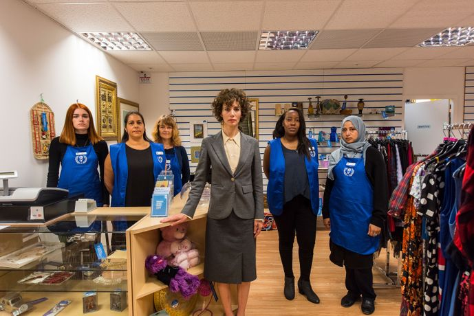 Miranda July and staff in the Interfaith Charity Shop. Photograph: Hugo Glendinning