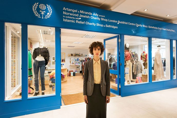 Miranda July in front of Interfaith Charity Shop. Photograph: Hugo Glendinning