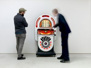 Image: People interacting with Susan Hiller's customised jukebox with 70 songs selected by the artist, London Jukebox, 2008-2018. Photograph: Todd White
