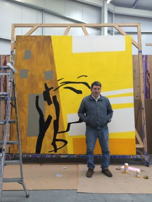 Bruce McLean in his studio
