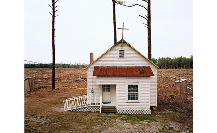 Burk Uzzle, Clear Cut Church, North Carolina, 2006. Archival pigment print, 44¼× 52¼ inches (112.4 × 132.7 cm). Courtesy of the artist. © Burk Uzzle.