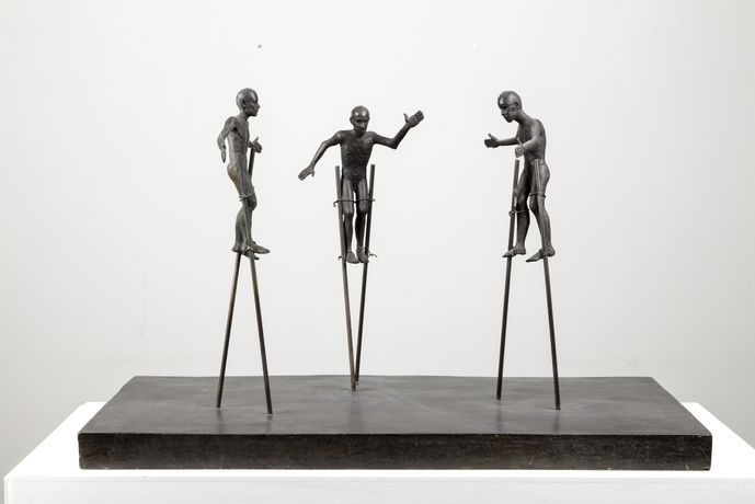 John Davies, Stilt Walkers, 1991, bronze, height 48.9cm, edition 1 of 3, copyright John Davies, courtesy Marlborough Fine Art