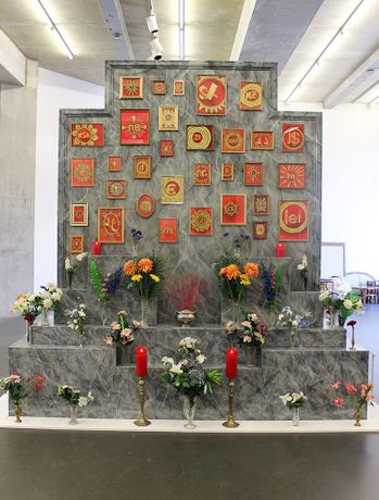 Faith In Fiat Bespoke trompe l'oeil marble shrine, ink and gouache currency drawings in recycled frames, faux flowers and vase collection, LED church candles. On view at the Towner, Eastbourne until 1st October.