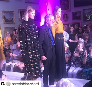 Chris Moore at the opening of Catwalking exhibition with models wearing Northumbria Fashion graduates collection