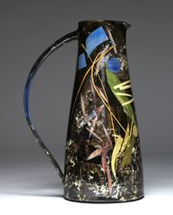 Sophie MacCarthy, Tall Jug, 'Leaves, Stalks, Shapes', slips, stencils and paper cuts, 32 cm. Courtesy of Ceramic Art London