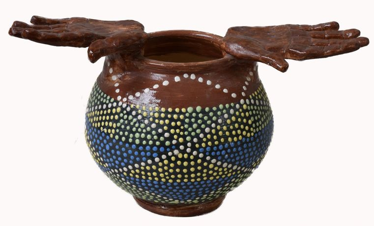 Dot patterned bowl with hands
