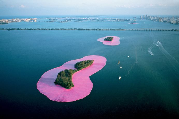 Christo and Jeanne-Claude. Documentary photograph of Surrounded Islands Biscayne Bay, Greater Miami, Florida, 1980–83. Woven polypropylene fabric surrounding 11 islands, Styrofoam, steel cables, and anchoring system. 6.5 million square feet of fabric overall. Photo: Wolfgang Volz. © Christo 1983