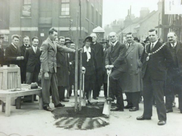 Alfred Salter, Planting a Tree of Heaven at the Opening of the Tanner Street Playground, May 1929 © Southwark Local History Library and Archive.