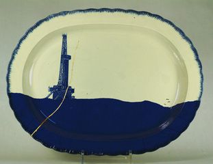 Paul Scott, 2014, Scott's Cumbrian Blue(s) Fracked No:3. Inglaze decal collage on cracked feather edged pearlware platter (c.1820) with gold, 43cm x 32cm x 3cm.