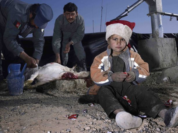 Mark Neville, 'Child, Jacket, Slaughtered Goat, Sweets, Painted Nails, Xmas Day, Helmand',  2010, c-type print