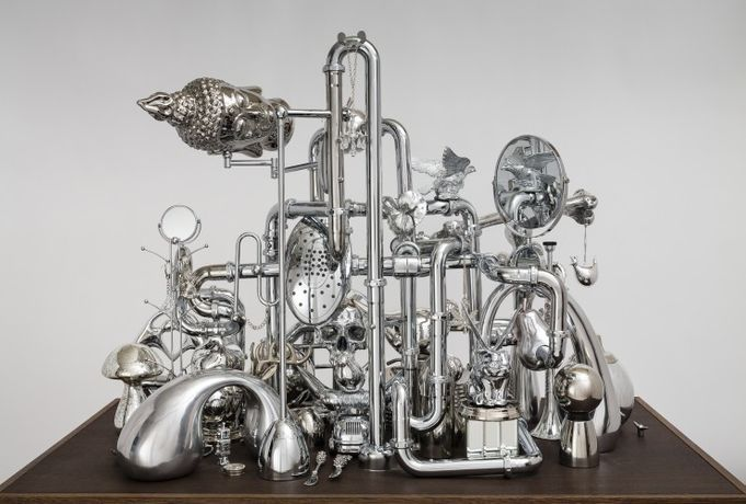 David Baskin, Vanitas, 2017, chrome metal, plastic, wood, 53 x 70 x 32 inches