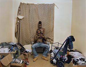 Deana Lawson Living Room, Brownsville, Brooklyn, 2015 Pigment print 35 x 45 inches (88.9 x 114.3 cm) Edition of 3
