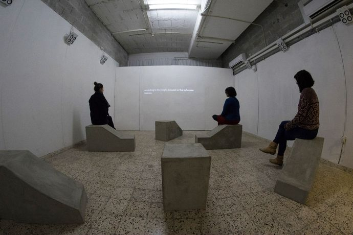 installation view, Shelters, 2016 / installation, 7 channel sound, video, 6 models for shelters made of concrete, 71 min.