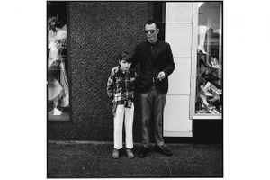Dennis Feldman: Father and Son, from the Hollywood Boulevard series, 1969–72 (printed 2018); black-and-white photograph mounted on aluminum; 40 x 40 in.; BAMPFA, gift of the artist.