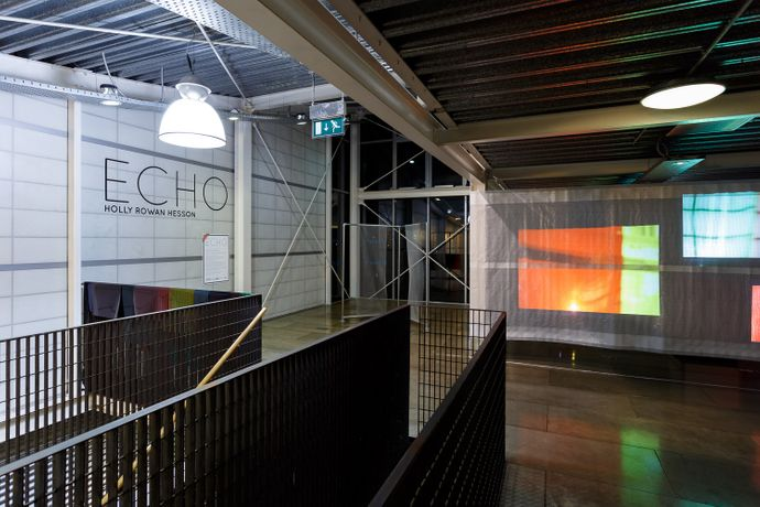 Holly Rowan Hesson - Echo (partial view), 2017, projection (looped series of 140 stills for each of six projectors), scaffold sheet, steel structure, webbing, lighting gels, dimensions variable (image credit Jules Lister)