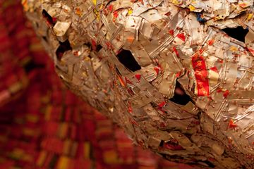 El Anatsui, AG+ BA (detail), 2014.  Aluminium, copper wire and nylon string. Dimensions variable. Photo: Jonathan Greet. Image courtesy October Gallery.
