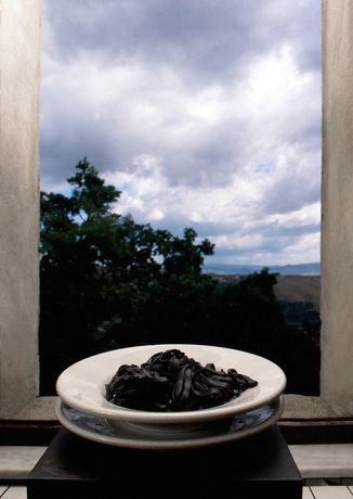 Pasto nero (Picnic o Il buon soldato) [Black Meal (Picnic or The Good Soldier)], 1998 Iron, ceramic, food 115 x 23 x 23 cm / 45 1/4 x 9 x 9 in (incl. base) Photo: Claudio Abate