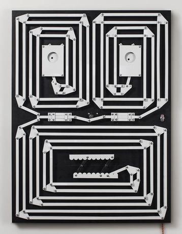 "Nick Doyle, ""They call it madness"", 2017, hand cut Dibond, laminate, nylon spacers, hardware, walnut, DC Motor, 40 x 30 inches – Image courtesy of the artist"