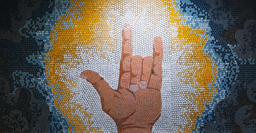 The mosaic depicts the sign I love you in International Sign—a contact variety of sign language used among deaf communities from different countries. Courtesy Moscow public municipal Kurchatov School, S.Y. Krivovyaz wing for hearing-impaired children №101. Photo: Anton Donikov