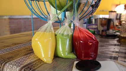 Laura Eldret, 'documentation for 3', bags of juice, 2014