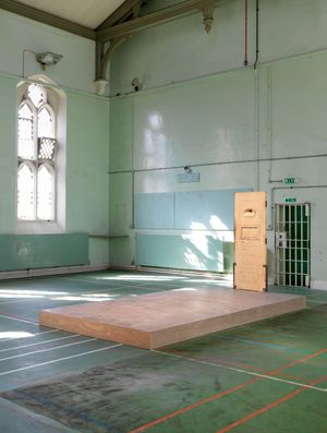 Jean-Michel Pancin's In Memoriam (2016). Materials: Concrete plinth, steel frame, Original wooden door to Oscar Wilde's cell. Courtesy the artist, Galerie Analix Forever and Galleries of Justice Museum, Nottingham. Installed in the old chapel which rises through the first and second floors of the Victorian wing of HM Prison Reading, part of Inside: Artists and Writers in Reading Prison. Photograph: Marcus J. Leith, August 2016