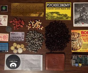 Fran Ilich, Untitled, 2005, Digital material, sunflowers, coins, French Revolution Sols, Zapatista and Kumiai solidarity bonds, cacao, Spacebank debit card, Ai Weiwei Sunflower Seeds, and more, Dimensions variable. Photo by Gabriela Ceja.