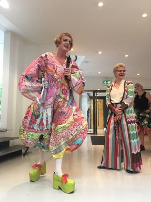 Grayson Perry opens exhibition in winning outfit
