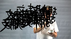 Image credit: FX Harsono, Writing in the Rain, video still courtesy the artist and Tyler Rollins Fine Art