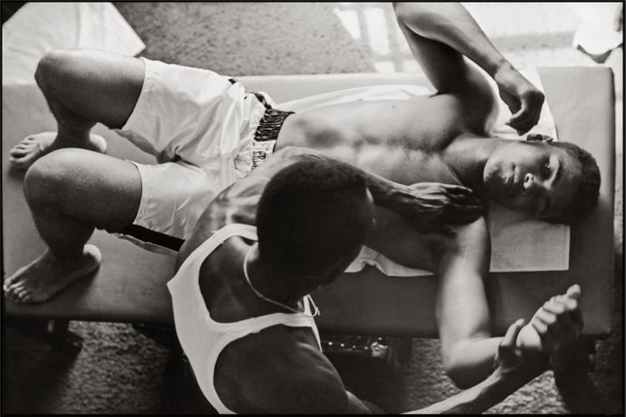 Trainer Works on Muhammad Ali's Shoulder, Miami, Florida, 1966 © Courtesy of and copyright The Gordon Parks Foundation