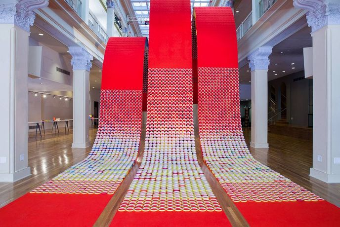 Yunhee Min,  Red Carpet in C, 2018 Collaboration with Peter Tolkin. Fabric and colored paper tubes. Culver Center of the Arts, UCR Arts. Photo credit: Peter Tolkin, TOLO Architecture.