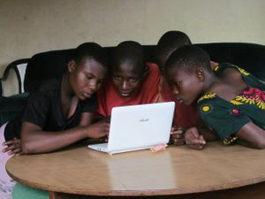 Esther Saliu, Rasaki Ajape, Opeyemi Olorunrotimi and Rebecca Olaniyi (left to right) teaching each other how to use the computer