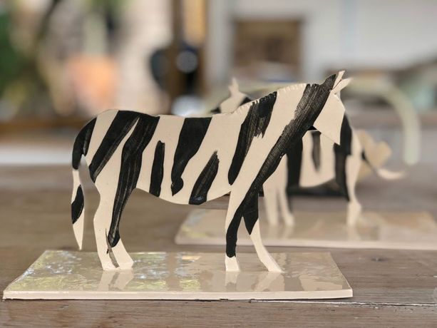 Pair of Zebra's, ceramic sculpture.