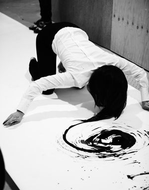 Hair Painting | 'I am a Brush', Live performance, 3.30 hours, 11 meter paper, ink, hair