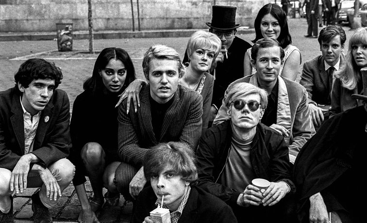 'Andy Warhol with Group at Bus Stop', New York, 1966. © Nat Finkelstein Estate