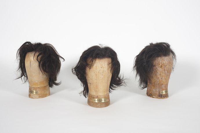 Ryan McGinness, RM Wigs (2008, 2009, 2011), 2011. artist's hair with stretch lace cap (hand tied construction) on wood head forms.