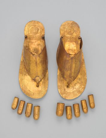 Sandals and toe stalls. New Kingdom. Dynasty 18, reign of Thutmose III (ca. 1479–1425 B.C.). Egypt, Upper Egypt, Thebes, Wadi Gabbanat el-Qurud, Wadi D, Tomb of the Three Foreign Wives of Thutmose III. Gold; sandals: L. 10 3/8 x W. 4 in. (L. 26.4 x W. 10 cm). The Metropolitan Museum of Art, New York, Fletcher Fund, 1922  (26.8.148a, b; 26.8.185–189, .193–.194, .198–.199)