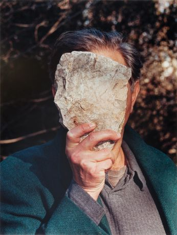 Jimmie Durham, Self-Portrait Pretending to Be a Stone Statue of Myself, 2006. Color photograph. Edition of 1 + 1 AP. 31 ¾ × 24 in. (80.7 × 60.9 cm). Collection of fluid archives, Karlsruhe. Courtesy of ZKM Center for Art and Media, Karlsruhe