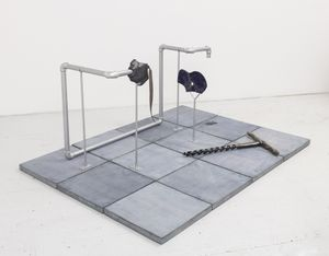 Julia Phillips. Extruder (#1). 2017. Partially glazed ceramics, screws, metal structure, metal pipes, concrete tiles, lacquer. Image courtesy the artist.
