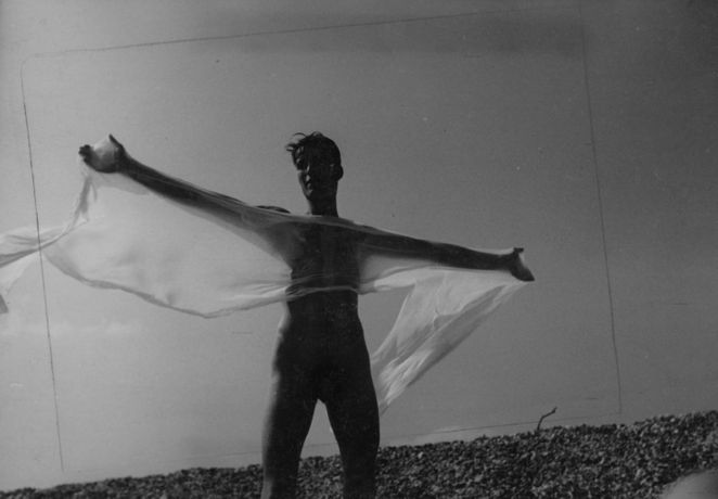 A male figure in silhouette holding wet cloth, 1930s