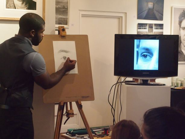 Kelvin demonstrating drawing techniques