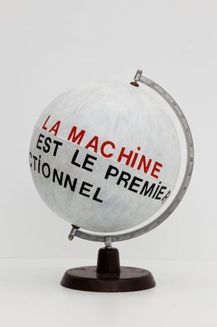 MANGELOS Le Manifeste sur la machine 1977-78 Acrylic and plastic letters on globe made of wood, metal and paper 14 3/16 by 18 1/8 in.  36 by 46 cm.